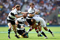 Rhodri Williams of the Barbarians is tackled in possession. Quilter Cup International match between England and the Barbarians on May 27, 2018 at Twickenham Stadium in London, England. Photo by: Patrick Khachfe / Onside Images