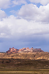 The upthrusting lighter Navajo Sandstone of the San Rafael Reef on the eastern edge of the San Rafael Swell monocline forms fantastic formations often referred to as the Silent City.  Mexican Mountain BLM Wilderness Study Area, near Green River, Utah.