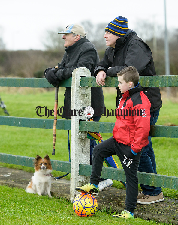 Limerick's John Daly with Sixmilebridge's Alan and Darragh Whyte watching the FAI Oscar Traynor game between Clare and Limerick. Photograph by John Kelly.
