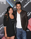 John Stamos and Jenna Ushkowitz at The T-Mobile Sidekick 4G Launch Party held at a private lot in Beverly Hills, California on April 20,2011                                                                               © 2010 Hollywood Press Agency