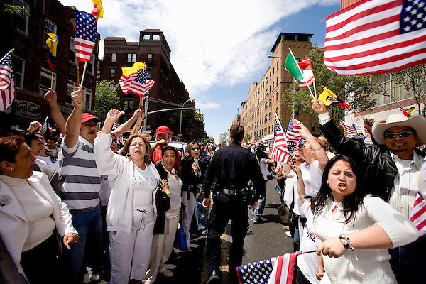 """Thousands of immigrants and their supporters rallied around the city today in solidarity, marking the """"Day Without Immigrants"""" celebrations nationwide. Walkouts, strikes and rallies were stages to show support for the legalization of undocumented workers.. A """"Human Chain"""" rally in Jackson Heights, Queens.. Police briefly argued with crowd members, trying to keep them out of the street.<br />"""