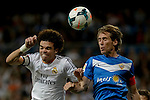 Real Madrid's Portuguese defender Pepe vies with Almeria's defender Raul Garcia during the Spanish league football match Real Madrid Madrid vs U.D Almeria at the Santiago Bernabeu stadium in Madrid on April 12, 2014  PHOTOCALL3000 / DP