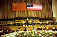 This photograph depicts President Ford making remarks at a Reciprocal Dinner in honor of the People's Republic of China (PRC) Official Party that he and First Lady Betty Ford hosted in the Peking Room of the Great Hall of the People. DEC 1975