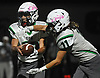 Matt Baltzer #10, Carle Place-Wheatley quarterback, left, fakes a handoff to running back John DeRidder #11 during a Nassau County Conference IV varsity football game against Mineola at Hampton Stadium in Mineola on Friday, Oct. 13, 2017.