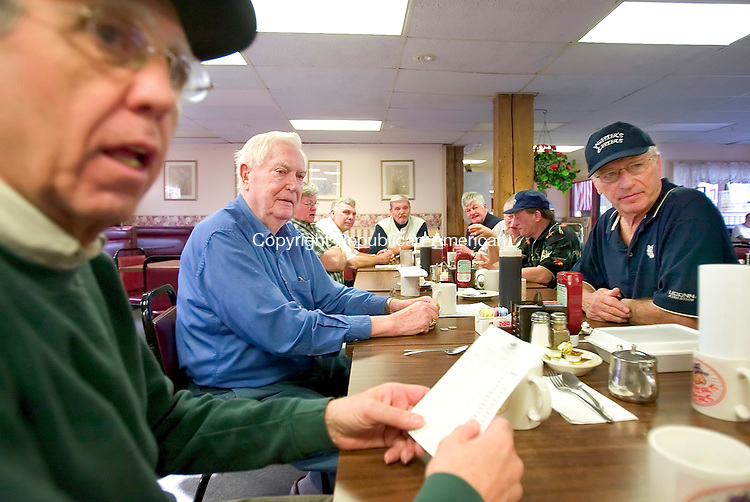 BANTAM, CT. 24 April 2007-042407SV03-- From left, John D&rsquo;Orio of Litchfield James Eisenhaure of Litchfield and Gus Dolmanisth of Shrewsbury, Mass. eat breakfast with a group of retired administrators from Wamogo High School in Litchfield that meet at Jackie's Restaurant in Bantam every Tuesday. They call themselves the Weezer's Geezers, and were founded by now deceased principal Perry Cavarly.<br /> Steven Valenti Republican-American