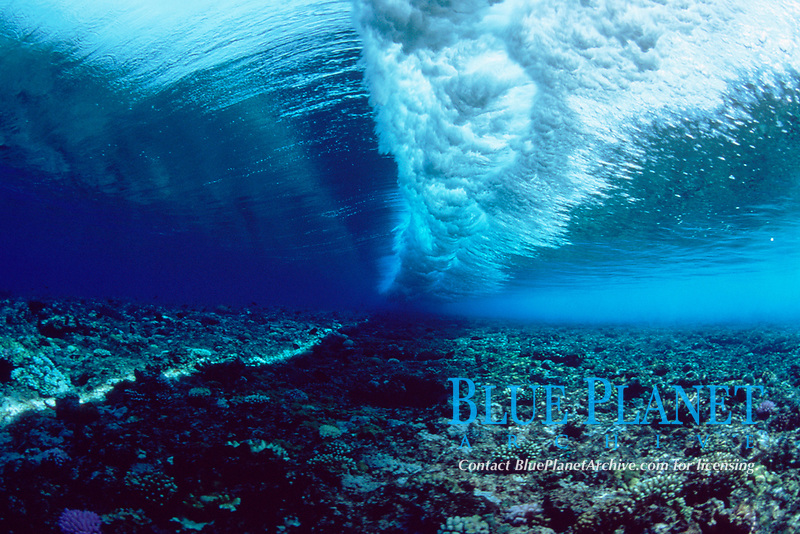 underwater view of a wave breaking on a shallow reef, Yap, Micronesia, Pacific Ocean
