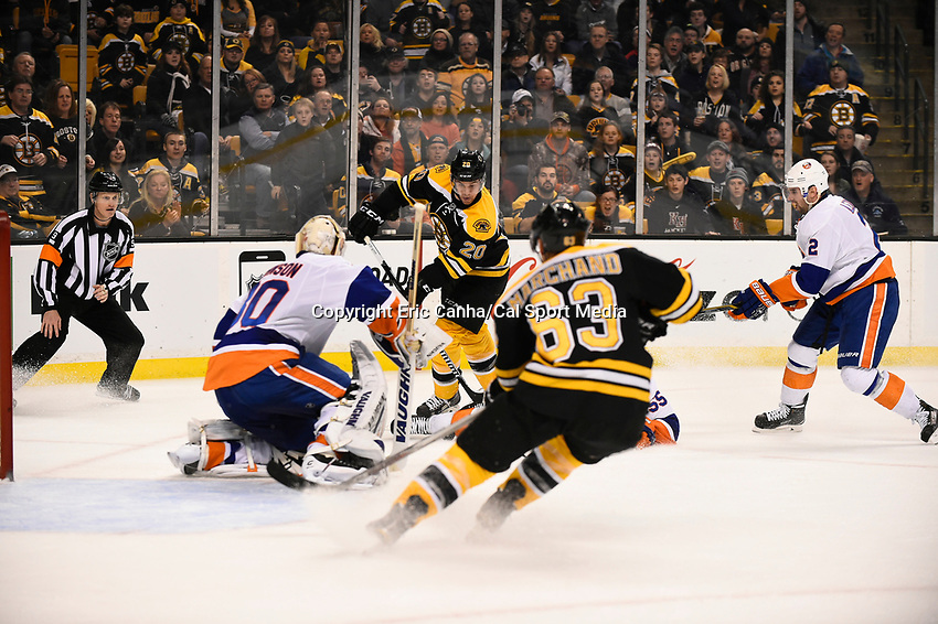 February 7, 2015 - Boston, Massachusetts, U.S. - Boston Bruins left wing Daniel Paille (20) goes on the attack against New York Islanders goalie Chad Johnson (30) in game action during the NHL game between the New York Islanders and the Boston Bruins held at TD Garden in Boston Massachusetts.    The Bruins defeated the Islanders 2-1 in regulation time. Eric Canha/CSM