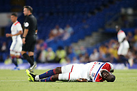 Oumar Solet of Lyon lies injured on the ground as the play continues around him during Chelsea vs Lyon, International Champions Cup Football at Stamford Bridge on 7th August 2018