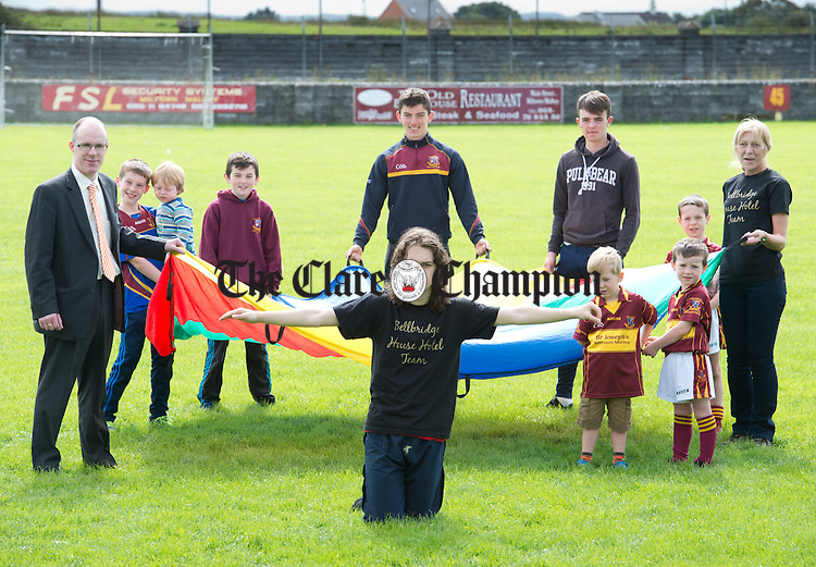 Liam O Halloran Bryant of Miltown Malbay who is doing a skydive in aid of the underage footballers in St Joseph's GAA Miltown, as well as raising awareness of autism. Looking on from behind are his sponsor David Mc Manus of The Bellbridge House Hotel and his mother Pauline as well as club players. Photograph by John Kelly.