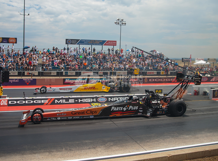 Jul 22, 2018; Morrison, CO, USA; NHRA top fuel driver Clay Millican (near) races alongside Richie Crampton during the Mile High Nationals at Bandimere Speedway. Mandatory Credit: Mark J. Rebilas-USA TODAY Sports