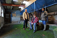 Pictured L-R: Campaigners Gareth Chapman, Gerald Miles and Jess Buchanan in the milking parlour of Trecadwgan farm near Solva. Friday 10 January 2020<br /> Re: Farmers campaigning to save a 14th century farm called Trecadwgan and keep it for a community project in Solva, west Wales, UK.