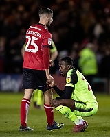 Bolton Wanderers' Joe Dodoo crouches in despair at the end of the match whilst shaking hands with  Lincoln City's Zak Elbouzedi (left) <br /> <br /> Photographer Andrew Kearns/CameraSport<br /> <br /> The EFL Sky Bet League One - Lincoln City v Bolton Wanderers - Tuesday 14th January 2020  - LNER Stadium - Lincoln<br /> <br /> World Copyright © 2020 CameraSport. All rights reserved. 43 Linden Ave. Countesthorpe. Leicester. England. LE8 5PG - Tel: +44 (0) 116 277 4147 - admin@camerasport.com - www.camerasport.com