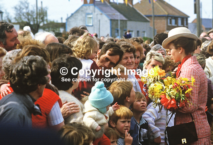 Princess Anne on a May 1985 Royal Visit to N Ireland meets villagers, young and old in the Co Down fishing village of Portavogie. She was there to officially reopen the harbour. 19850502c.<br /> <br /> Copyright Image from Victor Patterson, 54 Dorchester Park, Belfast, UK, BT9 6RJ<br /> <br /> t: +44 28 90661296<br /> m: +44 7802 353836<br /> vm: +44 20 88167153<br /> e1: victorpatterson@me.com<br /> e2: victorpatterson@gmail.com<br /> <br /> For my Terms and Conditions of Use go to www.victorpatterson.com