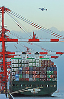 A large container ship unloads at the Evergreen container yard at Tokyo Bay, Tokyo, Japan..11 Jan 2005