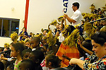 Students cheer during an academic pep rally at Wells Brown Elementary, hosted by UK's two time basketball national champion Wayne Turner, Friday, September 24, 2010.Turner has returned to UK to complete his degree and will graduate in May.  Photo by Theresa | Staff
