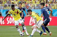 SARANSK - RUSIA, 19-06-2018: Jefferson LERMA (Izq) y James RODRIGUEZ (C) jugadores de Colombia disputan el balón con Hotaru YAMAGUCHI (Der) jugador de Japón durante partido de la primera fase, Grupo H, por la Copa Mundial de la FIFA Rusia 2018 jugado en el estadio Mordovia Arena en Saransk, Rusia. /  Jefferson LERMA (L) and James RODRIGUEZ (C) players of Colombia fight the ball with Hotaru YAMAGUCHI (R) player of Japan during match of the first phase, Group H, for the FIFA World Cup Russia 2018 played at Mordovia Arena stadium in Saransk, Russia. Photo: VizzorImage / Julian Medina / Cont