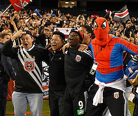 DC United midfielder Freddy Adu (9) celebrates with members of the Barra Brava. DC United tied the New York Red Bulls 1-1 and won on a 2-1 aggregate in their Eastern Conference Semifinals series on Sunday, November 29, 2006 at RFK Stadium.