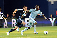 Sporting KC forward C.J Sapong (17) gets ahead of Vancouver Whitecaps defender Michael Boxall... Sporting KC defeated Vancouver Whitecaps 2-1 at LIVESTRONG Sporting Park, Kansas City, Kanas.