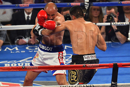09.04.2016. Las Vegas, Nevada, USA. Arthur Abraham (L) (Ger) throws a punch during the Abraham versus Ramirez WBO Super Middleweight World Championship fight in the MGM Grand Garden Arena at the MGM Grand Hotel and Casino in Las Vegas, Nevada. Gilberto Ramirez defeated Arthur Abraham by unanimous decision.