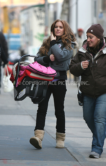 WWW.ACEPIXS.COM . . . . .  ....February 19 2008, New York City....Actress Isla Fisher leaving the set of her new movie 'Confessions of a Shopaholic' in Soho whilst carrying her baby and wearing a badge supporting Barrack Obama.....Please byline: PHILIP VAUGHAN - ACEPIXS.COM..... *** ***..Ace Pictures, Inc:  ..te: (646) 769 0430..e-mail: info@acepixs.com..web: http://www.acepixs.com
