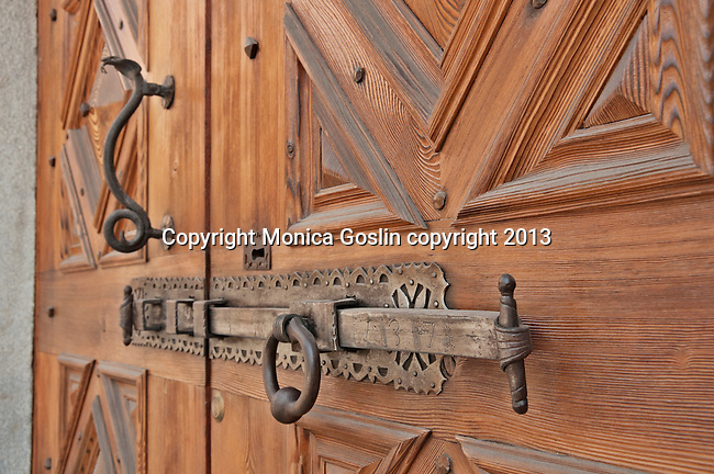 Door lock and door handle in the shape of a snake in Tirano, Italy