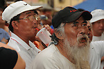 Bao-Jhong Yi-min Temple, Kaohsiung -- Spectators watching skimpily-clad pole dancers perform at the annual 'Divine Pig' (Shen Zhu) festival during Ghost Month.