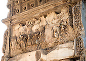Detail of the fresco showing the Golden Menorah in the Arch of Titus, located on the Via Sacra, just to the south-east of the Roman Forum in Rome, Italy, which was built to commemorate Titus's victory in Judea, depicts a Roman victory procession with soldiers carrying spoils from the Temple, including the Menorah, which were used to fund the construction of the Colosseum, on Wednesday, October 23, 2013.  It was constructed c. 82 AD by the Roman Emperor Domitian shortly after the death of his older brother Titus to commemorate Titus' victories, including the Siege of Jerusalem in 70 AD. The Arch is said to have provided the general model for many of the triumphal arches erected since the 16th century—perhaps most famously it is the inspiration for the 1806 Arc de Triomphe in Paris, France, completed in 1836.  This, the south panel, depicts the spoils of war looted from the Temple in Jerusalem after its destruction by the Romans. The Golden Menorah is the main focus and is carved in deep relief. Other sacred objects being carried in the triumphal procession are the Gold Trumpets and the Table of Shew bread. These spoils were likely originally colored gold, with the background in blue. In 2012 the Arch of Titus Digital Restoration Project discovered remains of yellow ochre paint on the menorah relief.  <br /> Credit: Ron Sachs / CNP