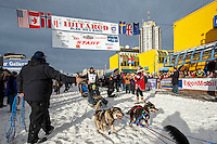 Charley Bejna and team leave the start line on 4th avenue during the Ceremonial Start of the 2016 Iditarod in Anchorage, Alaska.  March 05, 2016