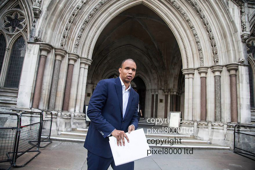 pic shows: <br /> <br /> <br /> <br /> World's number one poker star Phil Ivey leaves at the High Court in London today 2.10.14<br /> He arrived with his legal team carrying bundles of papers in his case against Crockfords casino in Mayfair, London which is owned by Gentings.<br /> <br /> The high stakes gambler who is suing Britain&rsquo;s oldest gaming club for withholding his &pound;7.3million payout<br /> They claim he was &quot;edge counting&quot;<br /> <br /> He arrived with two women of Asian appearance who may be part of his legal team or involved in the case.<br /> <br /> <br /> <br /> <br /> <br /> <br /> Pic by Gavin Rodgers/Pixel 8000 Ltd