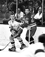Seals vs NY Rangers, Seals Gerry Ehman with the Rangers Ted Irvine. (1970 photo by Ron Riesterer)
