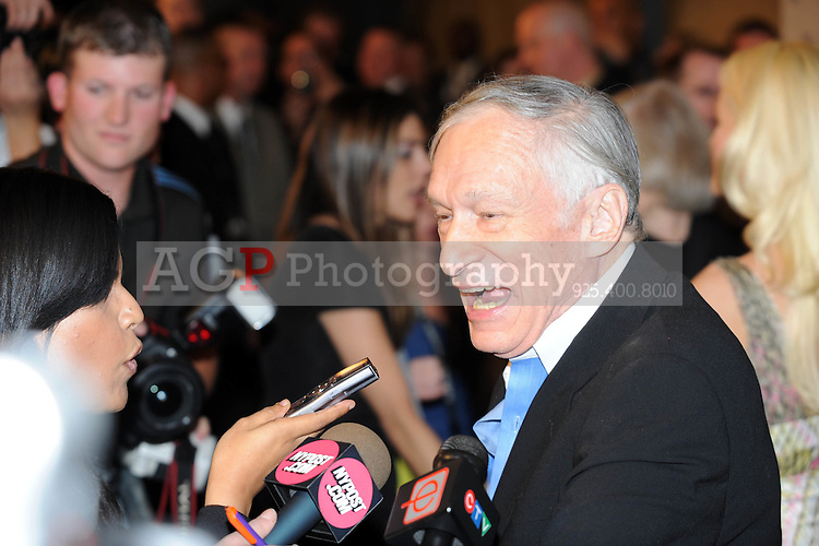 """Playboy Magazine founder Hugh Hefner talks with the media at Playboy's ninth annual """"Super Saturday Night""""  party in at Playboy's Desert Oasis and Resort in Chandler, Arizona Saturday February 2, 2008.   (Photo by Alan Greth)"""