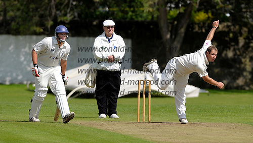 Carlton CC V Grange CC, Scottish National Cricket League, Premier Division, at Grange Loan, Edinburgh - Scotland collegues Gordon Drummond (left, Carlton) and Neil McCallum (right, bowling) but opponents on the day, with umpire Alex Dowdalls - Picture by Donald MacLeod 25.07.09