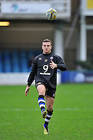 George Ford of Bath Rugby puts boot to ball during the pre-match warm-up. Aviva Premiership match, between Bath Rugby and Worcester Warriors on December 27, 2015 at the Recreation Ground in Bath, England. Photo by: Patrick Khachfe / Onside Images