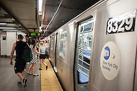 "Passenger disembark an ""L"" train at its Eighth Avenue terminal in New York on Monday, July 25, 2016. Because of salt water damage to the Canarsie tunnel from Hurricane Sandy the MTA will close the line down in Manhattan for 18 months affecting hundreds of thousands of commuters. Trains will end at Bedford Avenue and the shutdown will start in 2019. ( © Richard B. Levine)"