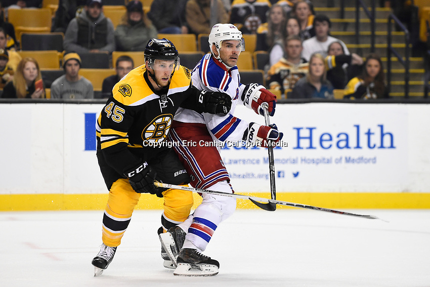 September 24, 2015 - Boston, Massachusetts, U.S. - New York Rangers defenseman Dan Boyle (22) and Boston Bruins defenseman Joe Morrow (45) in game action during the NHL game between the New York Rangers and the Boston Bruins held at TD Garden, in Boston, Massachusetts. The Bruins defeat the Rangers 4-3 in an overtime shoot out. Eric Canha/CSM