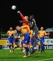 Lincoln City's John Akinde vies for possession with Mansfield Town's Neal Bishop, left, and Mansfield Town's Conrad Logan<br /> <br /> Photographer Chris Vaughan/CameraSport<br /> <br /> The EFL Sky Bet League Two - Mansfield Town v Lincoln City - Monday 18th March 2019 - Field Mill - Mansfield<br /> <br /> World Copyright © 2019 CameraSport. All rights reserved. 43 Linden Ave. Countesthorpe. Leicester. England. LE8 5PG - Tel: +44 (0) 116 277 4147 - admin@camerasport.com - www.camerasport.com