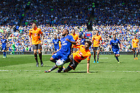 Junior Hoilett of Cardiff City falls in the penalty area under a challenge from Tiago Ilori of Reading but the appeals are waved away during the Sky Bet Championship match between Cardiff City and Reading at the Cardiff City Stadium, Cardiff, Wales on 6 May 2018. Photo by Mark  Hawkins / PRiME Media Images.