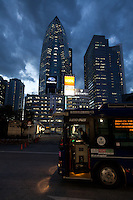 Shinjuku bus station at night infront of the Mode Gakuen Cocoon Tower in Shinjuku, Tokyo, Japan. Friday January 25th 2013