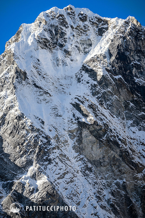 Ueli Steck and Tenjing Sherpa climbing Cholatse's North Face in October 2015, which they did in 12 hours. Tenji was the first Nepali to climb the north wall. The two climbers are seen as tiny dots on the north wall.