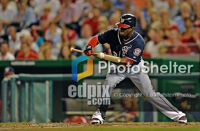 16 May 2012: Washington Nationals outfielder Roger Bernadina lays down a sacrifice bunt during game action against the Pittsburgh Pirates at Nationals Park in Washington, DC. The Nationals defeated the Pirates 7-4 in the first game of their 2-game series. Mandatory Credit: Ed Wolfstein Photo