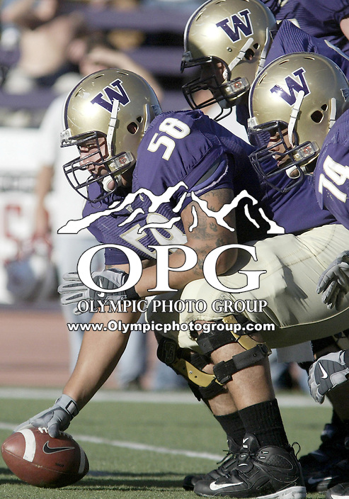 SEPT 23, 2006:  The Washington Huskies center Juan Garcia listens to the snap count from quarterback Isaiah Stanback before hiking the ball. UW won 29-19 over the UCLA Bruins at Husky stadium in Seattle, WA.
