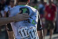 Reinardt Janse van Rensburg (ZAF/Dimension Data) helped 'a hand' after finishing having crashed earlier in the race<br /> <br /> 12th Eneco Tour 2016 (UCI World Tour)<br /> Stage 6: Riemst › Lanaken (185km)