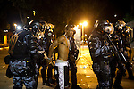 A man was arrested, and appears to have been peppered sprayed, during the rioting in downtown Rio de Janeiro, Brazil, Monday, June 17, 2013. Protests in Sao Paulo, Rio de Janeiro and other major Brazilian cities began with a 20-cent hike in public transport fares, have clearly moved beyond that issue to widespread frustration in Brazil about a heavy tax burden, politicians widely viewed as corrupt and woeful public education, health and transport systems and come as the nation hosts the Confederations Cup soccer tournament and prepares for next month's papal visit. <br /> <br /> Monday's demonstration brought a record 100,000 protestors who expressed their frustration at the heavy-handed policing, poor public services and high costs for the World Cup. The majority of Rio's protestors were peaceful, however a large group attacked the state legislature building, setting a car and other objects ablaze. Rio state security officials say at least 20 officers and 9 protesters were injured.