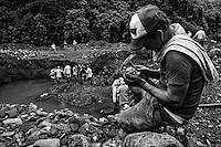"Emerald miners in Muzo, Boyaca department, Colombia. Digging in the mud in the outskirts of an emeral mine in Muzo, hundreds of people face a life of sacrifice and privations looking for those ""two minutes of good luck"" that will save them forever. Many of them dye in the attempt , few of them got any luck at all."