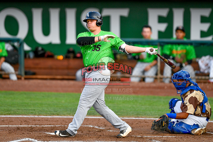 Corey Zangari (35) of the Great Falls Voyagers follows through on his swing against the Ogden Raptors during the Pioneer League game at Lindquist Field on August 18, 2016 in Ogden, Utah. Ogden defeated Great Falls 10-6. (Stephen Smith/Four Seam Images)