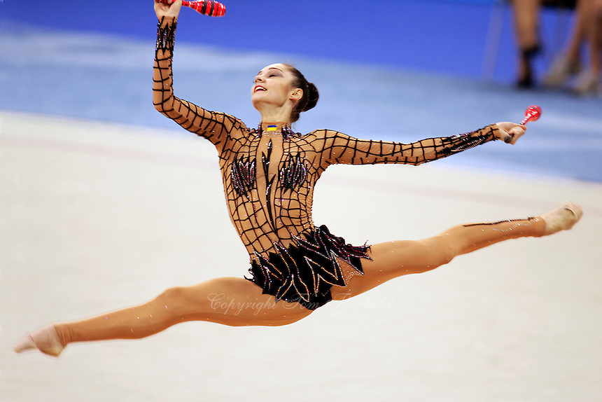 Anna Bessonova of Ukraine split leaps to re-catch clubs during All-Around final at 2004 Athens Olympic Games on August 29, 2006 at Athens, Greece. (Photo by Tom Theobald)