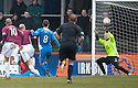 Queen of the South keeper Lee Robinson saves at close range from Arbroath's player / manager Paul Sheerin.