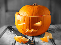Pumpkin with a traditional Haloween carved face