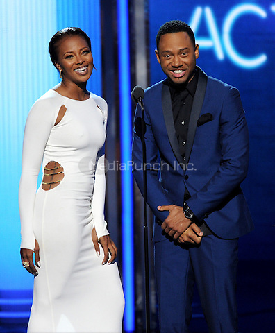 LOS ANGELES, CA - JUNE 29 : (L-R) Eva Marcille Pigford and Terrence J present the Best Actress award onstage at the BET Awards '14 at Nokia Theatre L.A. Live on June 29, 2014 in Los Angeles, California. Credit: PGMicelotta/MediaPunch