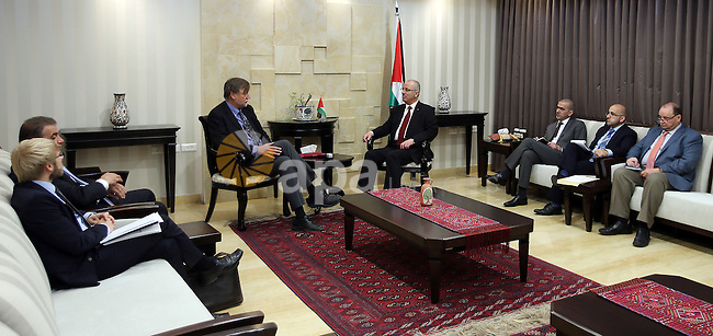 Palestinian Prime Minister Rami Hamdallah meets with World Bank representative in Palestine Sting Jensen in the West Bank city of Ramallah on April 04, 2016. Photo by Prime Minister Office